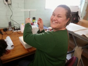 Dani M threading her overlocker.