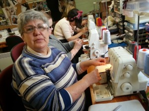 Sue threading her overlocker.