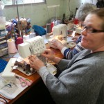 Kath threading her machine in the overlocker classes.