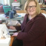 Lynne with her Janome overlocker