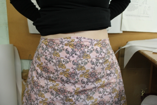 Front view of the Collette skirt that is sitting snugly into her body