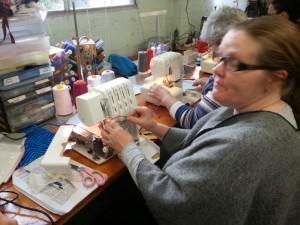 Kath threading her machine.